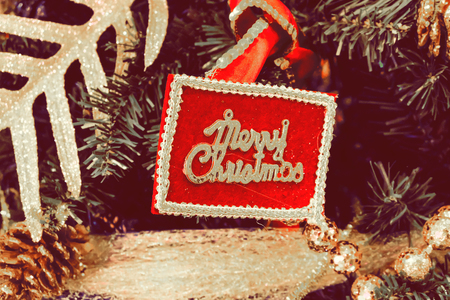 Christmas sign on Christmas tree. Banque d'images