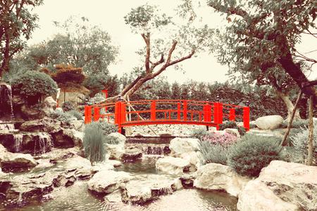 Wooden red bridge japanese style in garden.