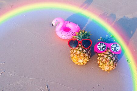 Tropical fruit pineapples on the sandy tropical beach.