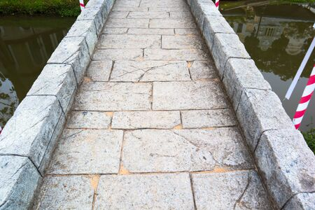 Stone bridge on summer in the park.