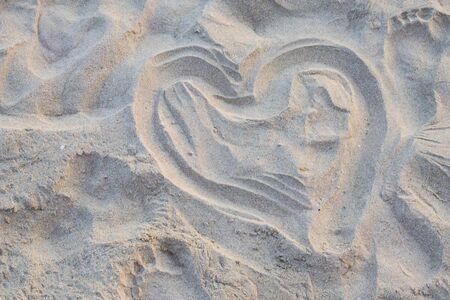 Heart shape drawn on sand at the beach. Stockfoto