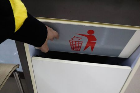 A women throwing garbage into recycle bin,waste bin at supermaket.