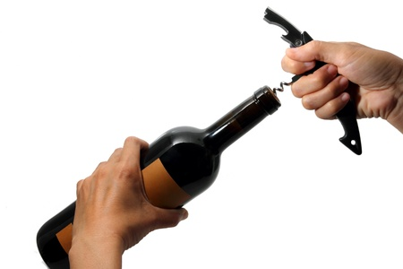 Opening a wine bottle, Waiters hands opening a wine bottle on white background   Stock Photo