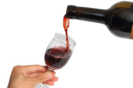 Pouring a glass of wine on white backgroud,Isolated