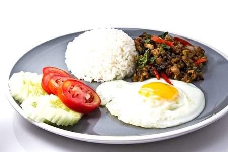 Stir Fried Pork with Holy Basil on white background, Thai Food photo