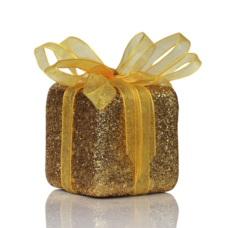 glitter gold gift box with bow isolated on white background