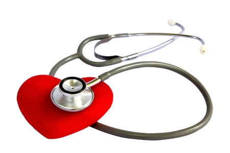 A stethoscope listening to a heart, health concept
