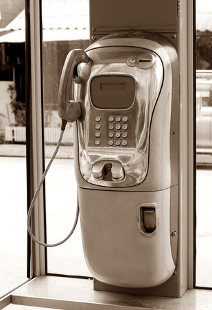 coin-operated telelephone,sepia Stock Photo