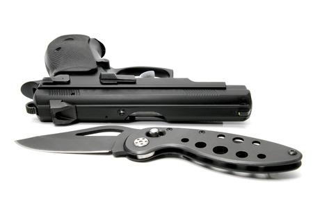 kozik: Gun and Penknife isolated on white background