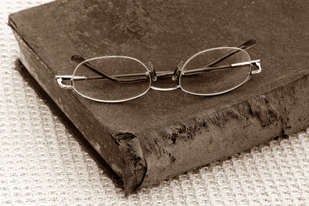 bifocals:  old bible and eye glasses,Sepia Stock Photo