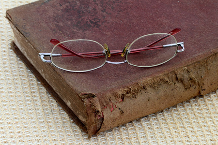 bifocals:  old bible and eye glasses Stock Photo