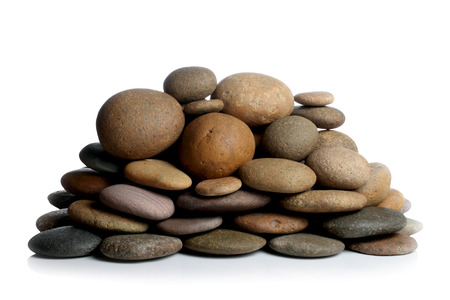 Piramid of stones. Isolated on white photo