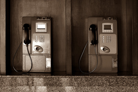 public coin-operated telephone-sepia