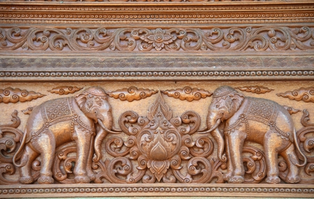 wood craft: Elephant carved on the wood in Thai temple, Chiang Mai, Thailand