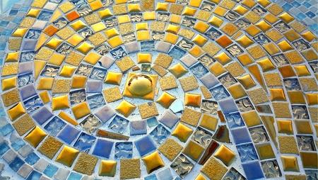 mosaic floor: Close up of Spiral pattern golden mosaic floor Stock Photo