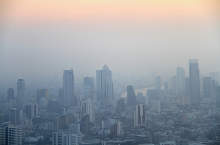 arial: Arial view of big city in misty sunrise morning, Bangkok, Thailand.