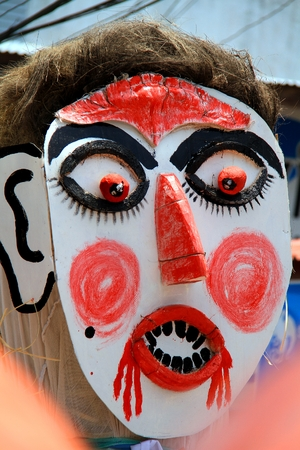 and is favorable: Loei province, Thailand- June 28,2014: Unidentified man wear ghost costume at  Phi Ta Khon or Ghost Festival at Dan Sai district, Loei province, Thailand.