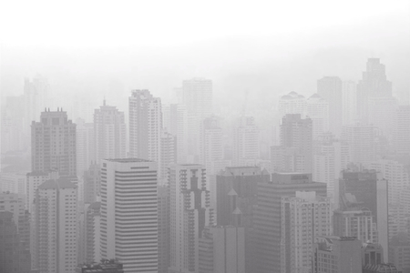 Aerial view of big city with air pollution / smog causing low visibility in the morning. Bangkok,Thailand