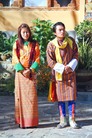 PARO, BHUTAN - November 10, 2012 : Unidentified couple of young dancers in colorful Bhutanese traditional cloths at Tiger Nest Resort, Paro, Bhutan