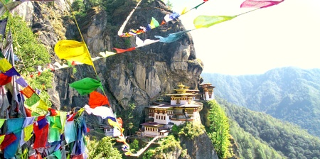 Taktshang Goemba or Tigers nest monastery with colorful Tibetan prayer flags, Paro, Bhutan. Stok Fotoğraf