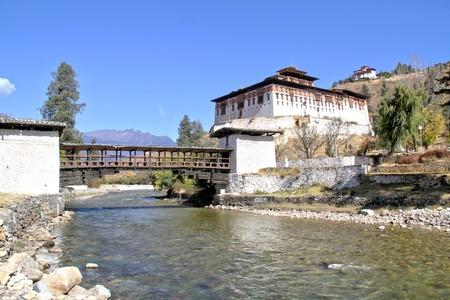 Paro Rinpung Dzong, The traditional Bhutan palace with wooden bridge across the river Paro Chu near to the city Paro, BHUTAN