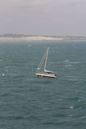 Yacht on open sea near White Cliffs of Dover Stock Photo - 5274072