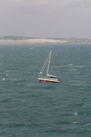 Yacht on open sea near White Cliffs of Dover Stock Photo - 5274072