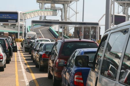 Row of cars waiting to board a ferry