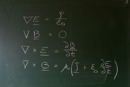 equations: Maxwells equations of electrodynamics written on a chalkboard