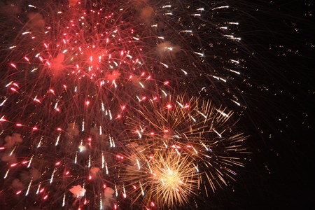 hogmanay: Celebrations - Colourful Fireworks Lighting up the Night Sky Stock Photo