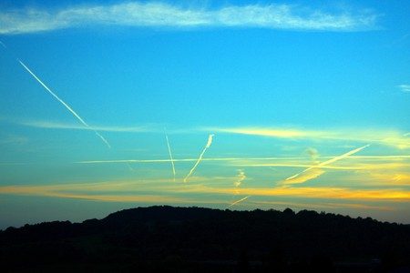 Aircraft Trail Lines Converging on a Clear Day