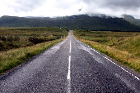 highland region: A Road Leading Off into the Distance in the Scottlish Highlands Stock Photo