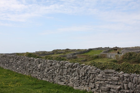 dry stone: A Dry Stone Wall Against a Blue Sky Stock Photo