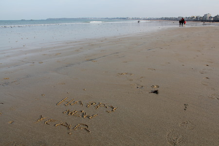 Happy New Year, Written in Sand at the Seashore