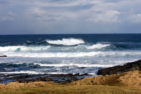 A Stormy Winter Day over the Sea in North Orkney, Scotland, UK