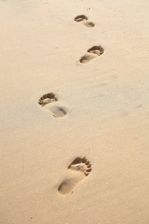 Foot stamp on sand  photo