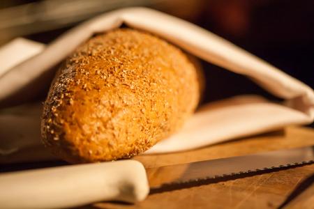 Sliced bread on cutting board closeup photo