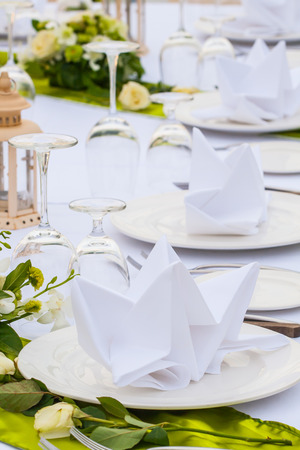 Elegant banquet wedding table setting photo