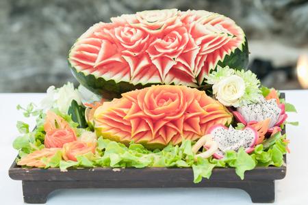 green papaya salad: fruit setup for wedding dinner on beach.
