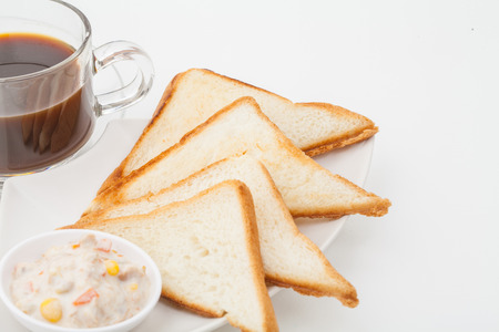 bread sandwich with tuna fish on white paper background photo