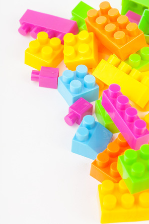 yellow lego block: Toy building colorful blocks on white paper background