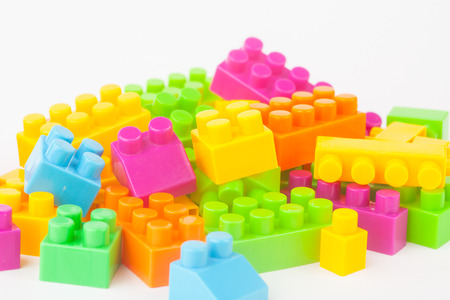 Toy building colorful blocks on white paper background photo