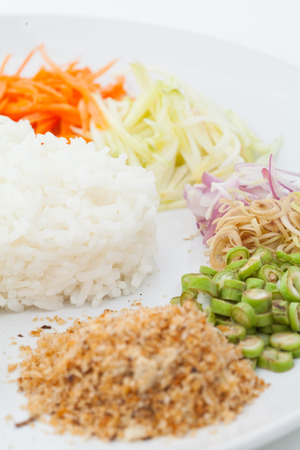 nasi: Nasi kerabu or kao yum, Southen Thai-Style rice with herbs and vegetables on white paper background
