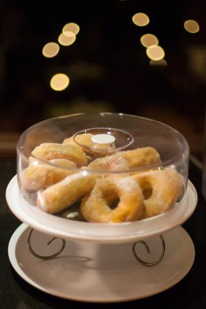 Mini sugar coated doughnuts piled photo
