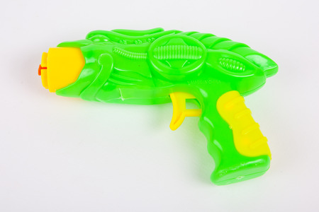 toy gun on white paper background
