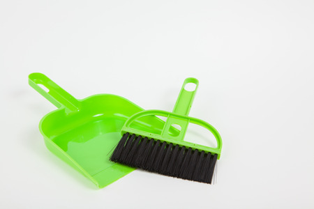 Garbage scoop and broom on white paper background photo