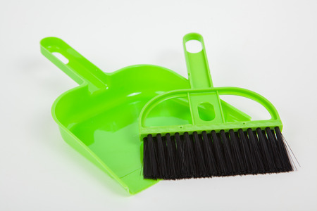 Garbage scoop and broom on white paper background Stock Photo