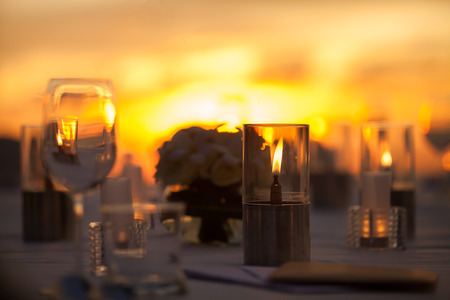 flower arrangement white table: Table Setting at a Wedding Reception on beach Stock Photo
