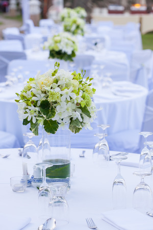 orchid flower: The elegant dinner table on the beach Stock Photo