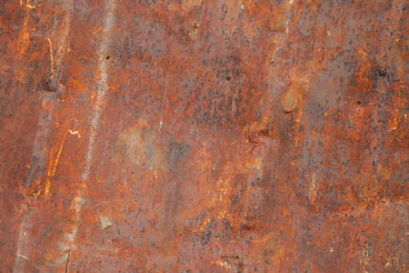 Close up of corroded iron plates and rivets on a wrecked ship. Background.